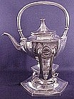 Antique teapot / kettle on stand with burner