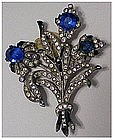 Diamond & sapphire floral spray pin ( faux unsigned )