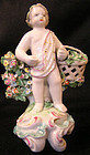 Derby Porcelain Figure of Putto carrying a basket