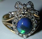 Ring with black opal & diamonds in heart and bow motif