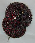 Brooch or pin of pave garnets in form of jockey cap