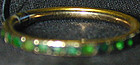 RING: 15K gold and green paste eternity band, circa 1780