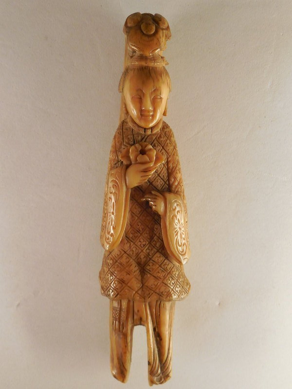 An Early Qing Dynasty Carved Bone Figure Of A Meiren