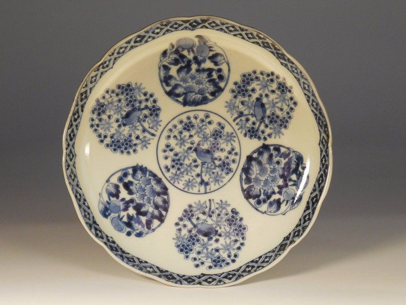 A Japanese Shonsui Style Blue & White Porcelain Foliate Dish, Roundels