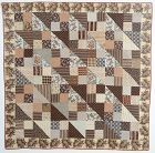 Glazed Chintz Four Patch with Triangles Quilt: Circa 1840