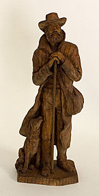 Carving of Frontiersman and his Dog