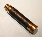 Small antique brass and leather three draw spyglass