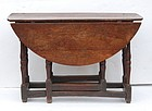 Early 18th C Cherry Gateleg table, circa 1710.