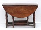 Early 18th C Cherry Gateleg table, circa 1710.