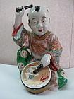 Famille rose -enameled porcelain statue  of a boy