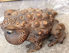 A carved wooden frog