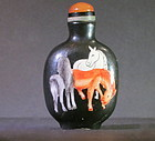 Enameled porcelain snuff bottle with horses