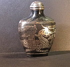 Silver inlay snuff bottle with warrior ridding a dragon