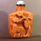 Chalcedony snuff bottle with monkey and horse