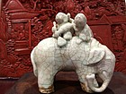 a porcelain elephant and children at play
