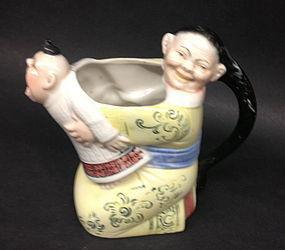 German Porcelain of a Chinese Mandrain creamer teapot