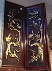 Pair of Chinese gilt dark wood panels