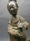 Chinese bronze sculture of a lady with vase