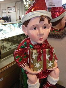 Elf sits on a gift box
