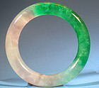 CARVED JADEITE BANGLE.