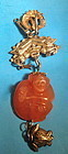 Chinese carved red agate monkey with silver chain