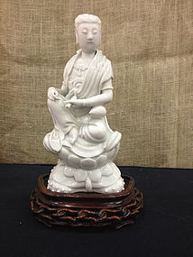 Chinese white porcelain Guangyin with carved base