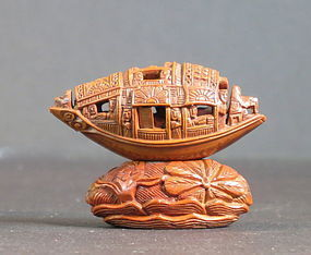 Carved olive pit 'Pleasure boat'