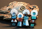 Four turquoise mother of pearl Kachina pendants