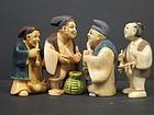 Group of polychrome Japanese ivory netsukes
