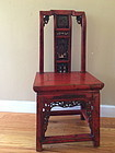 Chinese antique lacquer chair with carved panel