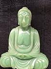 Chinese green hard stone seated figure of the Buddha