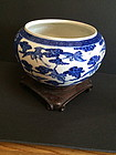 Chinese blue and white porcelain bowl with wood base