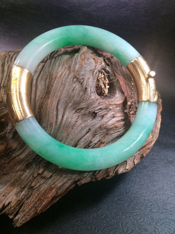 A jadeite bangle bracelet with gold fitting