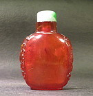 Antique Chinese amber carved snuff bottle jadeite top