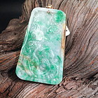 Chinese carved jadeite pendant with gold frame