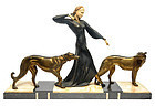 An Art Deco patinated and gilt metal, onyx, slate and faux ivory figur