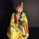 Famille Rose enamelled porcelain figure of Ji Gong