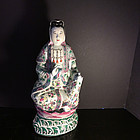 A famille Rose enamelled porcelain figure of Guanyin