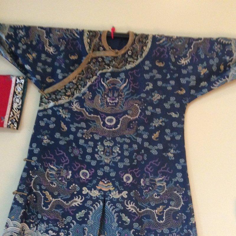 An embroidered blue silk Kesi dragon robe