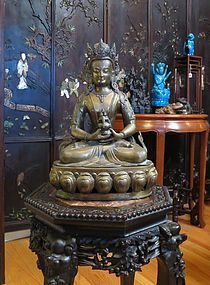 Case bronze brass figure of a seated Buddha
