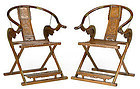 A pair of Chinese carved yellow rosewood folding horseshoe chairs