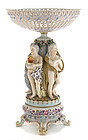 A German porcelain floral encrusted figural centerpiece
