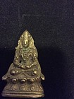 miniature metal figures of Buddha