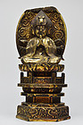 Gilt-wood figure of seated Horse-headed kannon with three faces