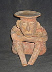 A SEATED JALISCO FIGURE FROM WEST MEXICO