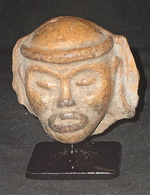 A LARGE MAYA ORANGEWARE POTTERY URN FRAGMENT DEPICTING A HUMAN FACE