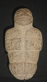 A DIQUIS STANDING STONE MALE DEITY OR WARRIOR