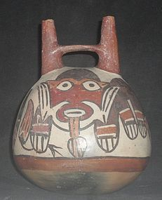 AN UNSURPASSED EXAMPLE OF A NAZCA DOUBLE SPOUT GLOBE