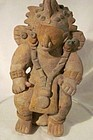 A SUPREMELY ORNAMENTED AND DIGNIFIED JAMA-COAQUE FIGURE FROM ECUADOR
