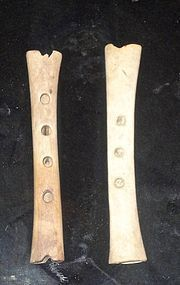 TW0 ALMOST IDENTICAL BONE FLUTES/CENTURIES AND CULTURES APART